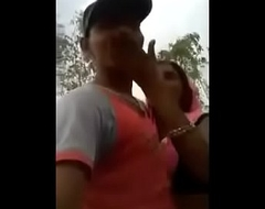 Indian mommy outdoor giving a kiss